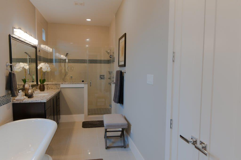 For the beautiful spa-like master bath: Large Frameless Glass Shower with 6 Shower Heads Spa-like Master Bath with separate sinks and free-standing soaking tub