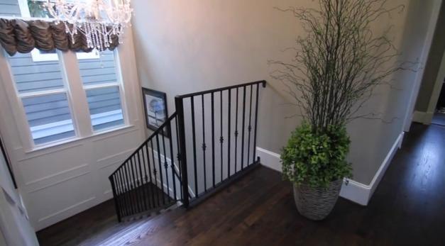 Landing area of second floor; stairs, handrail, lighting.