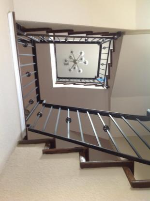 Wood Stairs - Wrought Iron Railing