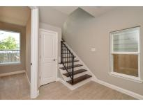 Front entry way features custom tile flooring with access to the first floor bedroom and bathroom.