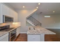 The designer kitchen features beautiful granite counter tops, stainless steel appliances, subway tile back splash and white cabinets with an option of ash color as well. Please check selection package for colors and materials.