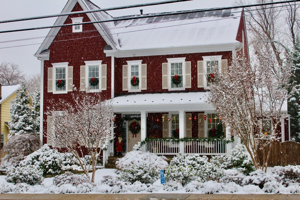 two-story home in the snow.